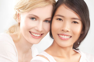 Two beautiful women show off their eyes - Rejuvenate your eyes at Elan Medical Skin Clinics in central London and Essex