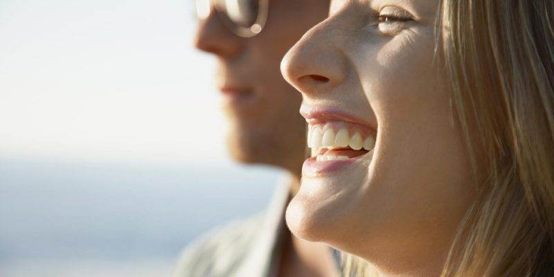 Couple smiling safely in the sun after reading Elan Medical Skin Clinic's blog about sun spots