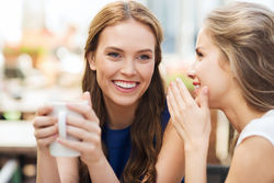 Friends chat through the refer a friend offer at Elan Medical SKin Clinics in London and Essex